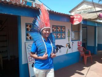 A Chieftain's smile: Natoyah Fields tries on the Wai-Wai headdress at a tourist shop at Lethem, Rupununi.