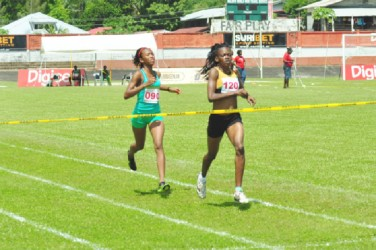 All Guyana! Guyana's Jevina Straker and Cassie George earned a one-two finish in yesterday's 1500m event by almost 250 metres. (Orlando Charles photo)