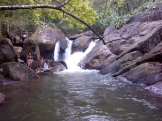 Tourists at the Kumu Falls