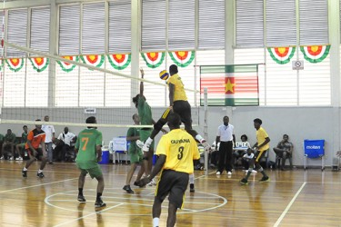 Captain Creston Rodney going in for one of his kills last night in Guyana's five-set victory over Suriname. (Orlando Charles photo)