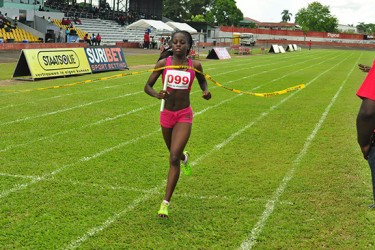 All Alone! Jevina Sampson anchoring Guyana's 4x400m relay team to victory without a Surinamese in sight. (Orlando Charles photo)