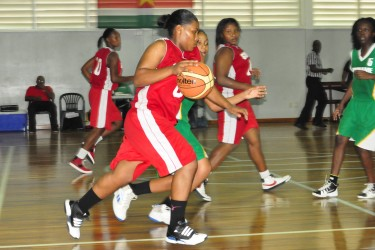 Action during another blowout win for the Guyanese ballers. (Orlando Charles photo)
