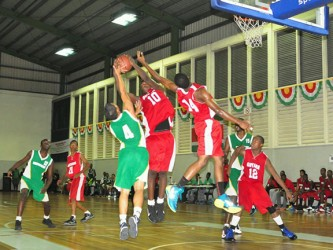 Action during the Suriname/Guyana male basketball game Saturday. (Orlando Charles photo)