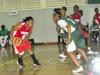Guyana's female under-19 basketball captain, Tamara Hunter (no.6) is about to blow by one of her defenders in Saturday 47-29 blowout win. (Orlando Charles photo)
