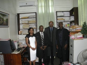 In this Zoisa Fraser photo Jervis poses with from left to right, his mother Say Jervis, attorney Lester Caesar and Justice Rishi Persaud moments after he was accepted to the local Bar