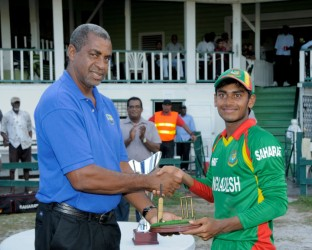 The Chairman of WI selectors Clyde Butts presents Mehedy Hasan with Man-of-the-Series prize.(Photo courtesy of West Indies Cricket photostream)