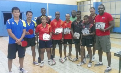 The Guyana A and B teams with Suriname Table Tennis Association president Desire Hooghart fifth from right.
