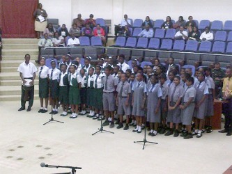 A joint choir of children from South Ruimveldt Secondary and the St Stanislaus College treat invitees to folk songs during one of the interludes at the opening ceremony of the 16th Biennial Regional Conference of Presiding Officers and Clerks of the Caribbean, the Americas and the Atlantic Region of the Commonwealth Parliamentary Association (CPA), at the Guyana International Conference Centre.