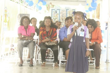 """Former East Street Nursery student Chadency Christmas performing her calypso, """"The Golden Key"""" at the commissioning of the rebuilt school yesterday"""