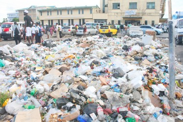 Garbage piled up outside Stabroek Market in the vicinity of the Timehri Bus Park. (Arian Browne photo)