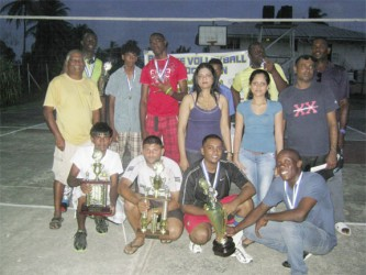 The winning PMTC 1 team posing with their trophies and medals.