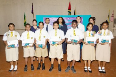 RightStart NGSA 2013 Awardees with Officers of Republic Bank (Guyana) Limited and the Principal at Queen's College. (Republic Bank photo)