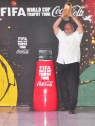 President Donald Ramotar holds the FIFA World Cup Trophy aloft. (Orlando Charles photo)
