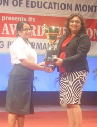 Best Overall CSEC student Yogeeta Persaud receiving her award from Minister of Education Priya Manickchand at the Ministry's 2013 national award ceremony. (GINA photo)
