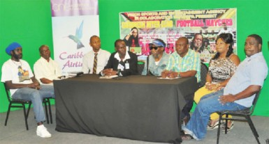 Vizion Sports and Entertainment Agency CEO Wally Fraser (fifth from left) addressing the gathering at the launch of the Caribbean Inter-Club Football Matches while the other members of the launch committee look on.
