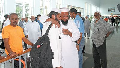 These two Muslim pilgrims share an emotional embrace at the Piarco International Airport yesterday, after failing to acquire visas to make the annual Hajj pilgrimage to Mecca. A group of 87 T&T pilgrims was denied visas to Saudi Arabia after travelling to Venezuela, the only place where they are issued in this part of the world.
