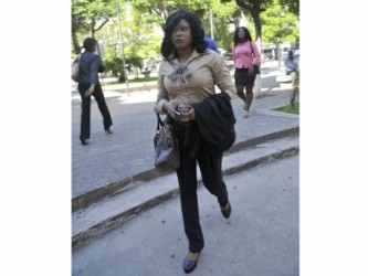 Shanique Myrie on her way to the Supreme Court in downtown Kingston yesterday morning for a live video link to the CCJ headquarters in Trinidad and Tobago. (Jamaica Gleaner photo)