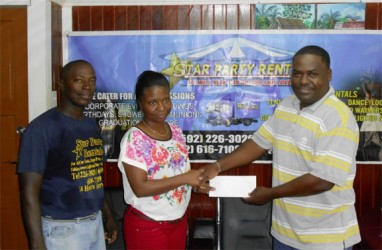 GFA Treasurer Dexter Schultz (right) collecting the sponsorship cheque from Star Party Rental Office Manager Pheona Jones while company Supervisor Floyd Spencer look on