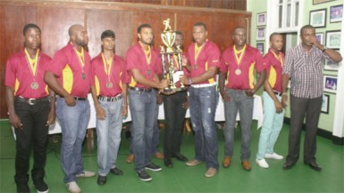 The winning DCC team along with President Alfred Mentore (far right)