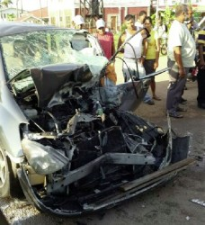 The crushed car, in which Murshid (leader) of the Guyana Islamic Trust (GIT) Haseeb Yusuf and two foreign nationals were travelling, after the collision with a truck at Skeldon, Corriverton, early yesterday morning