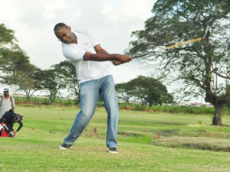 OFF YOU GO! Gregory Dean, Digicel CEO tees off to get this year's Guyana Open golf tournament underway yesterday morning at the Lusignan Golf Club. (Orlando Charles photo>