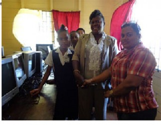 From left, Michelle Barton (Head of Gibson Primary School) and Natasha Baburam (Committees Manager for Food For The Poor)