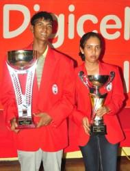 Guyana Open golf winners Avinda Kishore and Christine Sukhram with the trophies. (Orlando Charles photo)
