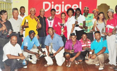 The winners of the 2013 Digicel sponsored Guyana Open with their trophies. (Orlando Charles photo)