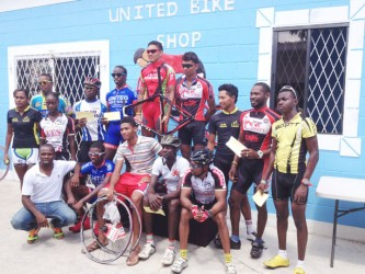 Winners and runners up pose with their spoils following the presentation ceremony of the inaugural United Bike Shop 70-mile road race.
