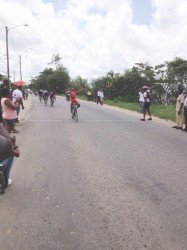 Well Done! National rider, Alanzo Greaves celebrating after crossing the finish line in yesterday's inaugural United Bike Shop 70-mile road race.