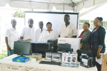 Representatives of the various technical institutes pose for a photo with their equipment along with Inge Nathoo and Chairman of the TVET council and the TVET Director Clinton Williams and Sydney Walters respectively. (Government Information Agency photo)