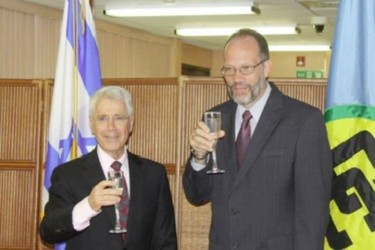 Amiram Magid (left) and Irwin LaRocque sharing a toast (Caricom photo)