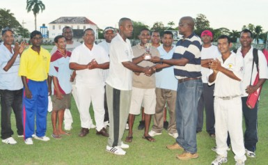 Man-of-the-match Clifton Anderson receiving his MVP award from former national fast bowler Robert `Pacer' Adonis