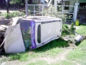 The Toyota Probox lying across the ditch