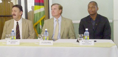 From left SKYE Chief-of-Party Dr. Jan Karpowicz, US Ambassador Brent Hardt and GCCI President Clinton Urling at the launching of the SKYE project job bank on GCCI's website yesterday