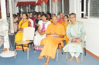 Swami Aksharananda (left in front row) was the guest speaker at the satsangh. At right in front row is Christopher Persaud