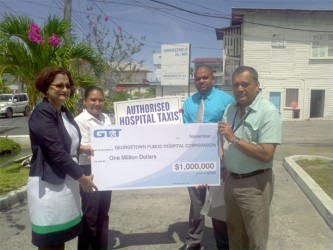 GPHC's CEO Michael Khan receives cheque for $1M from GT&T's Marketing & Public Relations Director Roma Narayan-Singh. In background (L to R) are Nadia De Abreu, PRO of GT&T and Robbie Rambarran, Assistant Director of Finance at GPHC.