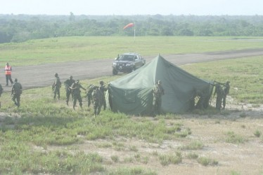 Guyana Defence Force ranks establish the triage area on arrival at the crash site (GINA photo)