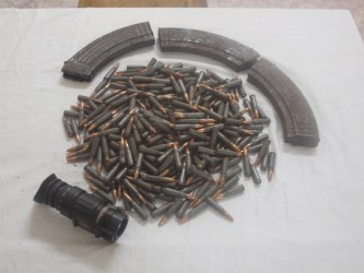 The three AK-47 rifle magazines, rounds of 7.62 x 39 ammunition, and telescopic night vision lens recovered by police after a shootout during a drug eradication exercise at 15 Miles, Ituni Backdam on Thursday afternoon. (Guyana Police Force Photo)