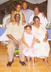 Gordon Alleyne and his family, (back row) his daughter Karen Williams and her husband Owen Williams, daughter Maxine Alleyne (front row) George, his wife Evelyn and their granddaughter Keyanne.