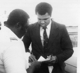Gordon Alleyne getting an autograph from boxing champion Muhammad Ali.