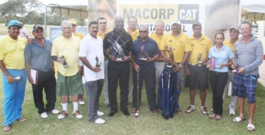 MACORP Invitational Golf tournament winner Jaipaul Suknanan (fifth from right) poses with the other winners and MACORP representatives.