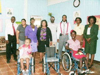 In photo are two of the recipients of the wheelchairs with officials of the hospital.