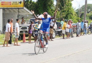 Team United's Orville Hinds celebrating his stage win yesterday on Homestretch Avenue.