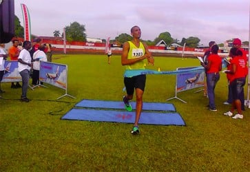 Lionel D'Andrade crossing the finishing line to clinch the top spot in the men's open division of the Suriname Marathon