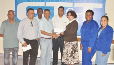 GCB Secretary Anand Sanasie (fourth from left) receives the sponsorship cheque from GT&T Director of Sales, Marketing and Public Relations Roma Narayan-Singh, while other representatives of the GCB and GT&T look on.