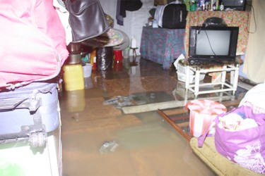 A flooded house in Victoria Street, Albouystown last evening.