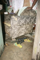 One Albouystown resident used concrete blocks to prop up his chair.