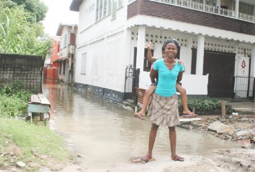 Look mommy the whole street is flooded! This mother and daughter were  photographed in Smyth Street yesterday.