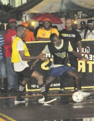 Devon Charles of Berlin Massive attempting to dribble his Stevedore Housing Scheme marker in their Group-A matchup
